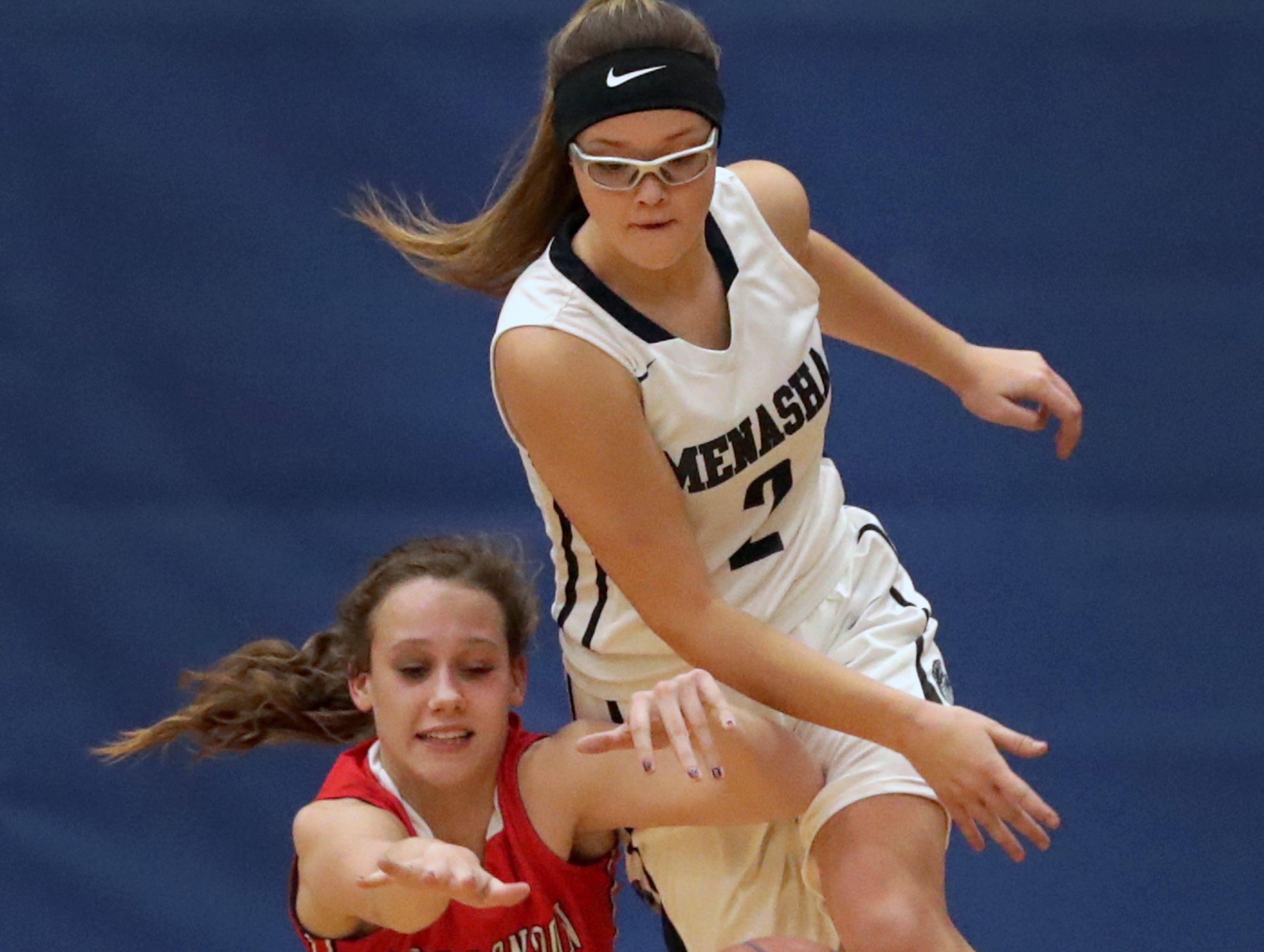 New London High School's #23 BreAnna Hacker against Menasha High School's #2 Kendall Olszewski during their girls basketball game on Friday, December 14, 2018, in Menasha, Wis.Wm. Glasheen/USA TODAY NETWORK-Wisconsin.