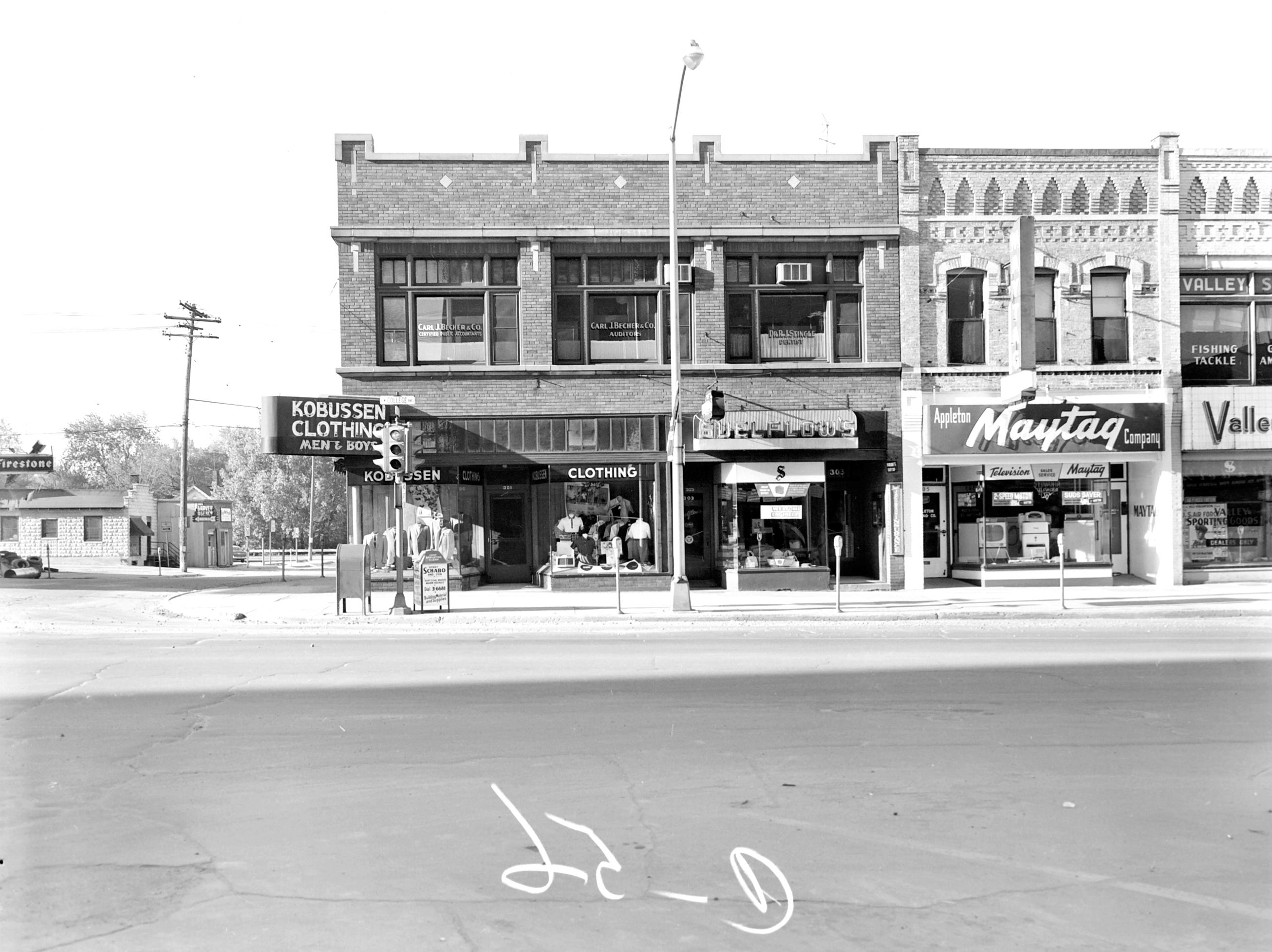 1957 Downtown Appleton. 300 West block on the south side of College Avenue: Kobussen Clothing. Suelflow's Travel. Appleton Maytag. Valley Sporting Goods.  Post-Crescent photo by staff.