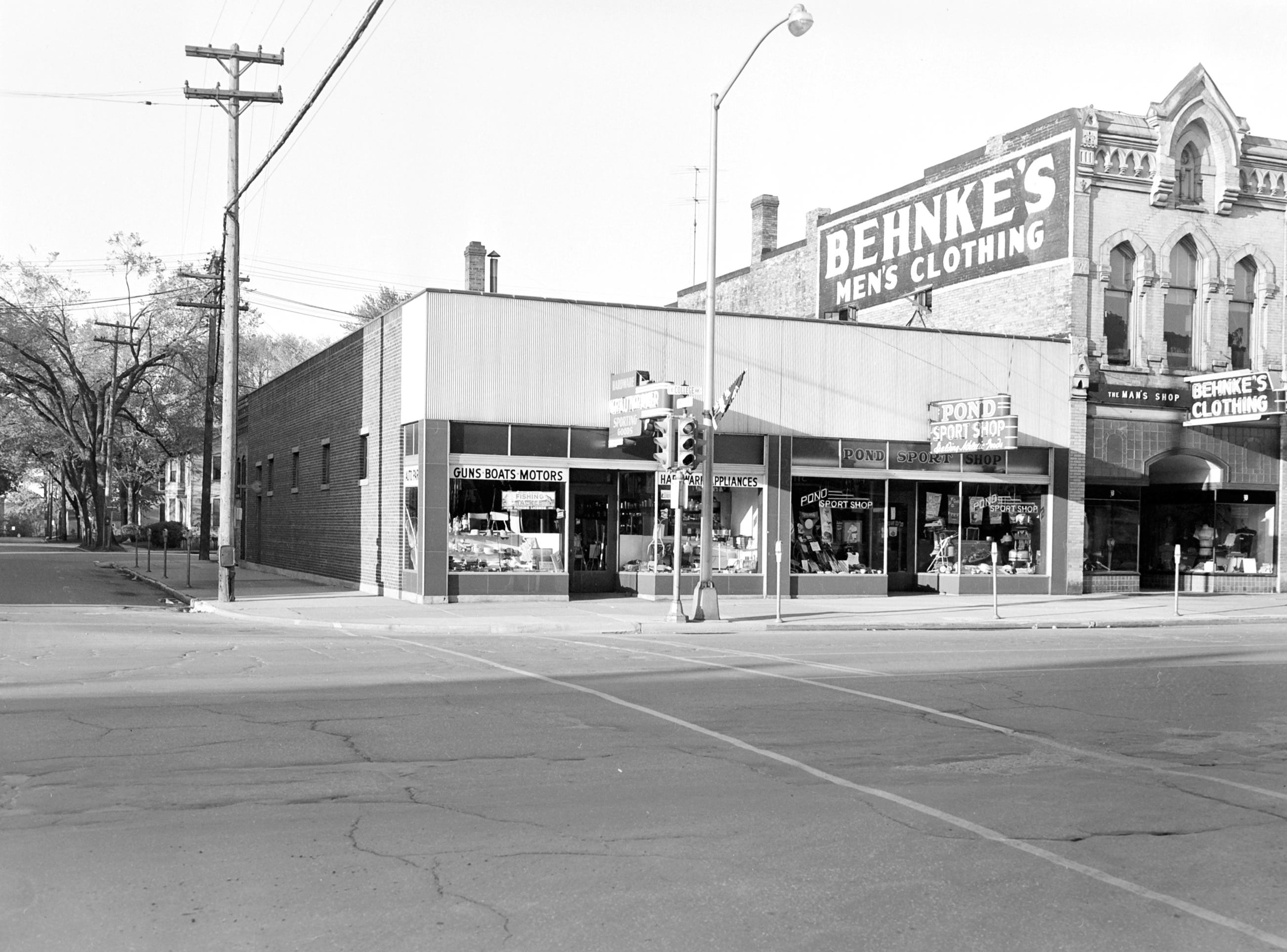 1957 Downtown Appleton. 100 East block on the south side of College Avenue: Pond Sport Shop. Behnke's Men's Clothing. Post-Crescent photo by staff.