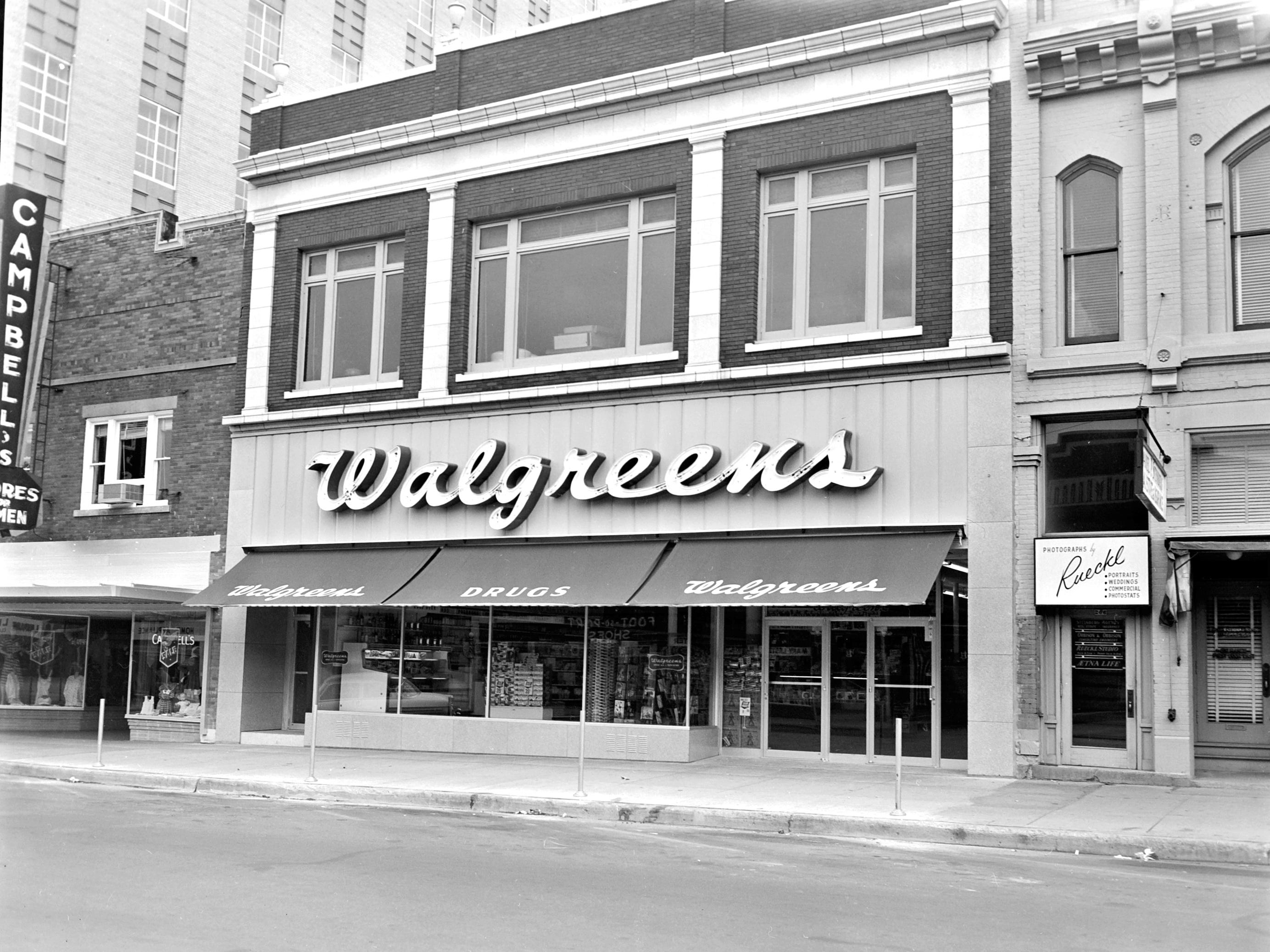 1957 Downtown Appleton. 100 West block on the north side of College Avenue: Campbell's. Walgreen's. Rueckl Studio. Post-Crescent photo by staff.