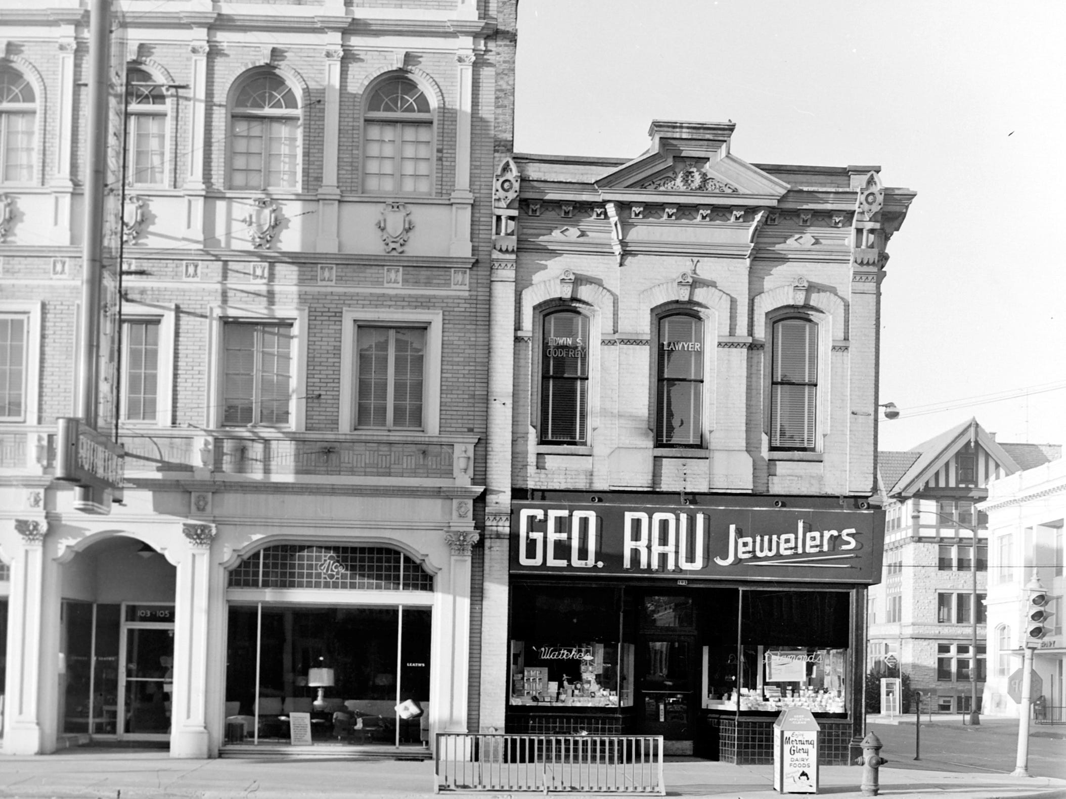 1957 Downtown Appleton. 100 East block on the south side of College Avenue: Leath Furniture. Geo. Rau Jewelers.  Post-Crescent photo by staff.