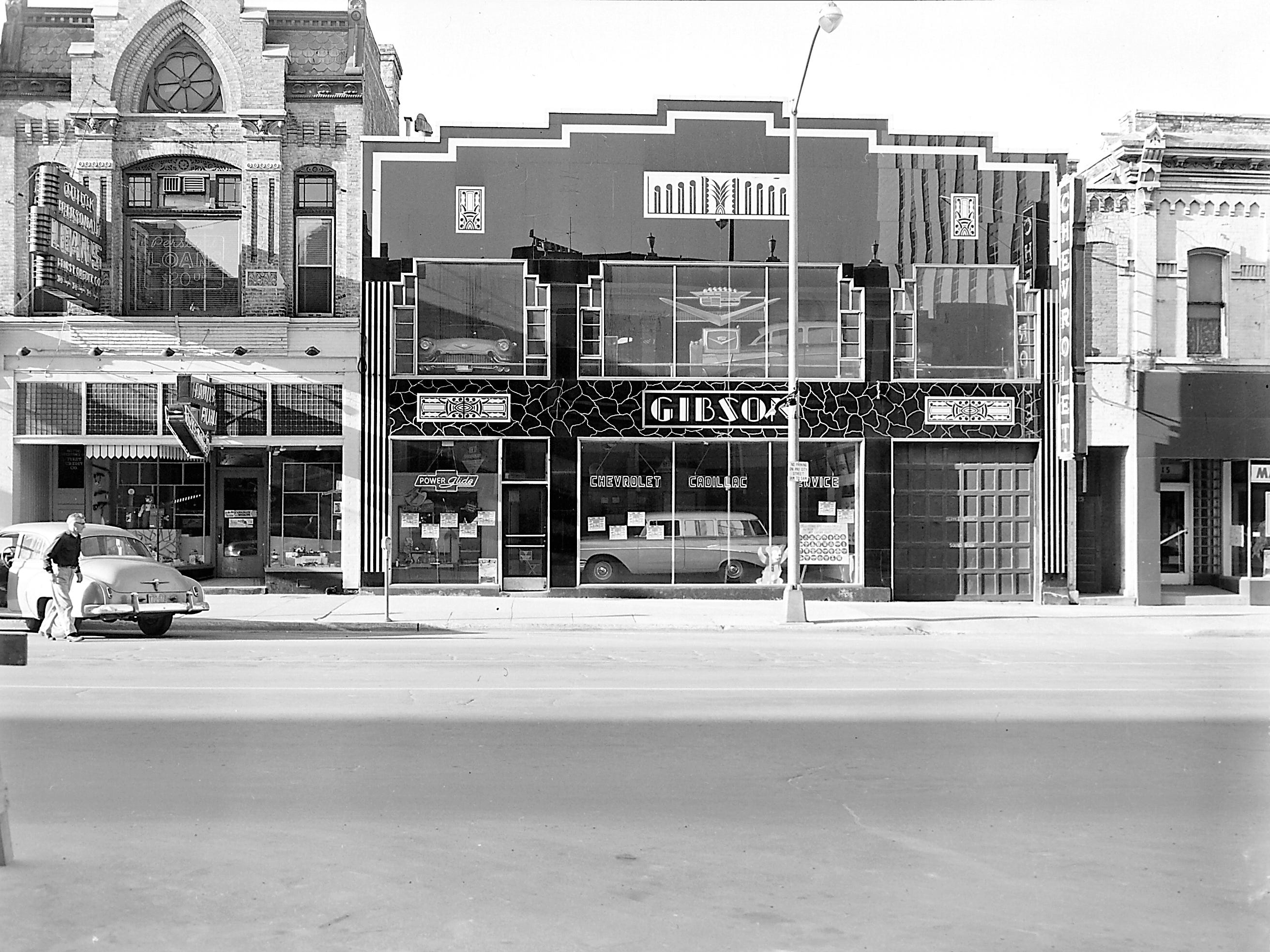 1957 Downtown Appleton. 200 West block on the south side of College Avenue: SHOP. Gibson  Motors. Mary Lester Shop. Post-Crescent photo by staff.