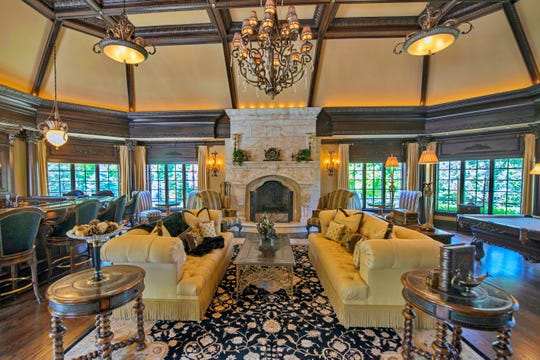 The living room features custom windows and coffered ceilings.