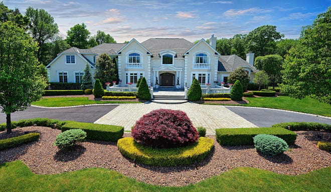 Colts Neck home hallmarked by timeless design at 2 Secretariat Drive.