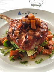 The Christmas Day menu at The Rum Runner in Sea Bright includes the Dark & Stormy pork chop.