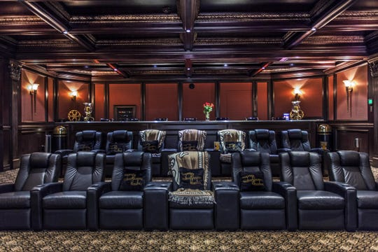 The theater features seating for 21 and a decorative crown molding.