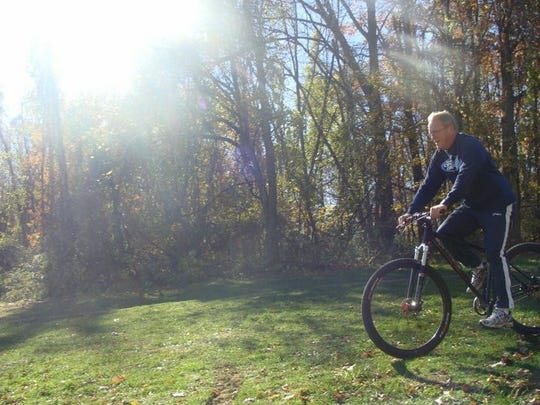 Kevin Attridge riding his bike during cross country practice.