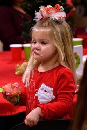 Hadlee Painter, 3, gives Santa Claus a look up-and-down after he entered the room at the Abilene Zoo. Breakfast with Santa is the zoo's annual Christmas fundraiser and was sold out.