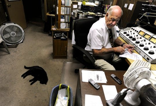 Jim Baum searches through his audio recorders for the evening's Colorado City Council meeting June 11, 2013. Baum was the mayor and owner of KVMC/KAUM radio. After each meeting, Baum returned to the station to edit together a report for the next morning's newscast.