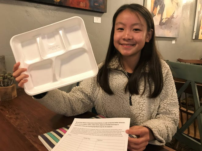 Vicky Gao, a 13-year-old Craig Middle School student, shows off the polystyrene (Styrofoam-like) lunch trays  on which students in the Abilene Independent School District receive their food each day. Vicky created a petition to end their use due to damage to the environment.