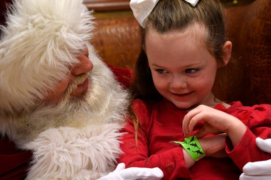 Kynzie Colmery, 6, shares her Christmas wish with Kris Kringle at the Abilene Zoo.