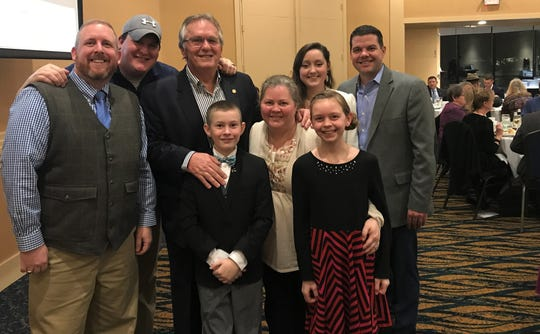 Sen. Mike Nofs, center, with his family at his surprise retirement event. Back row from left, Michael John Nofs, Matt Nofs, Sen. Nofs, Hanna Smith, John Thompson. Front row from left, Owen Michael Nofs, Julie Nofs and Emelia Nofs.