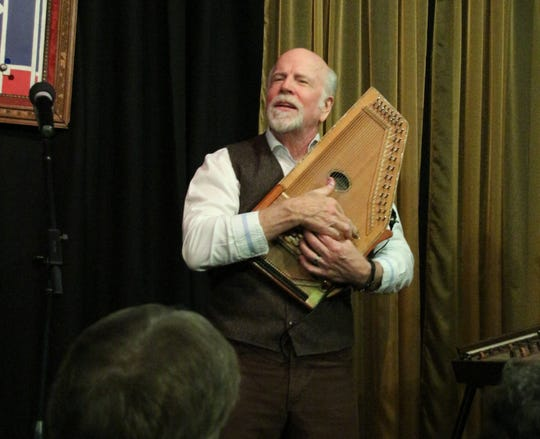 John McCutcheon plays the autoharp during his performance at 6 On The Square in Oxford in February.