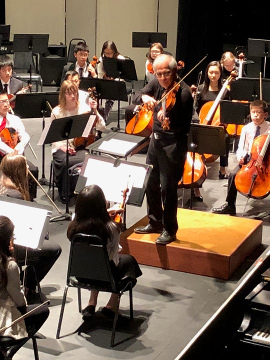 Augusto Diemecke, conductor of the Youth Orchestra of the Southern Finger Lakes, works with students during a rehearsal earlier this year.