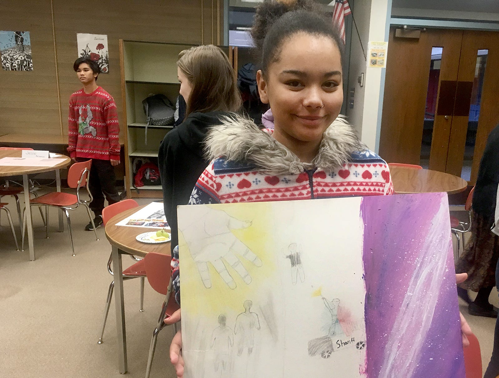 "Fairview Middle School student Kylie Moniz showed a galaxy of stars in her artwork for a project in Amy White's U.S. History class, focused on the history of racial discrimination. Moniz was one of three students of color in her first grade class. ""I felt like I was floating alone in a galaxy,"" she said."