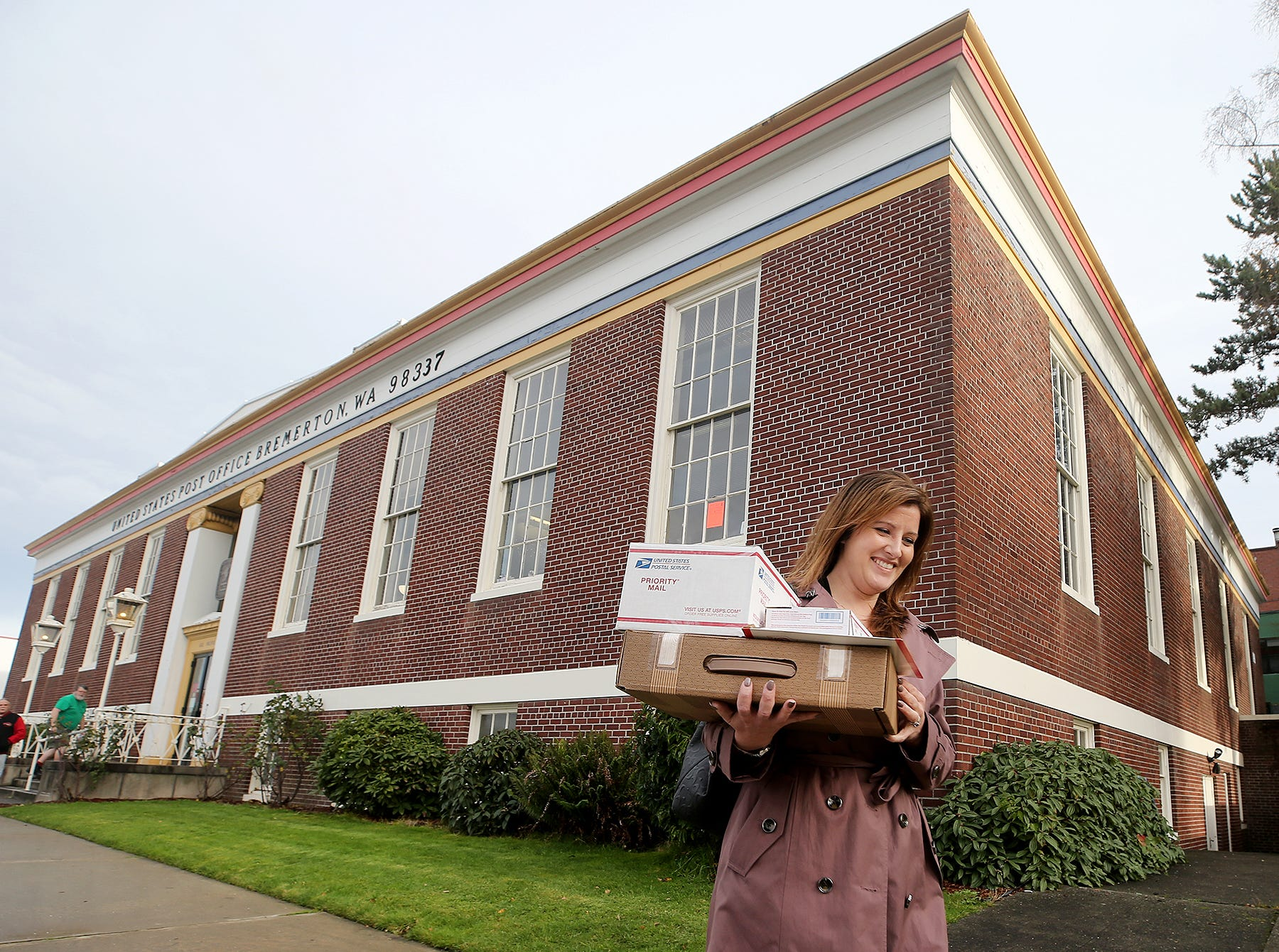 Teresa Bryant picks up fun Christmas gifts for her family at the downtown Bremerton Post Office on Monday, December, 17, 2018.