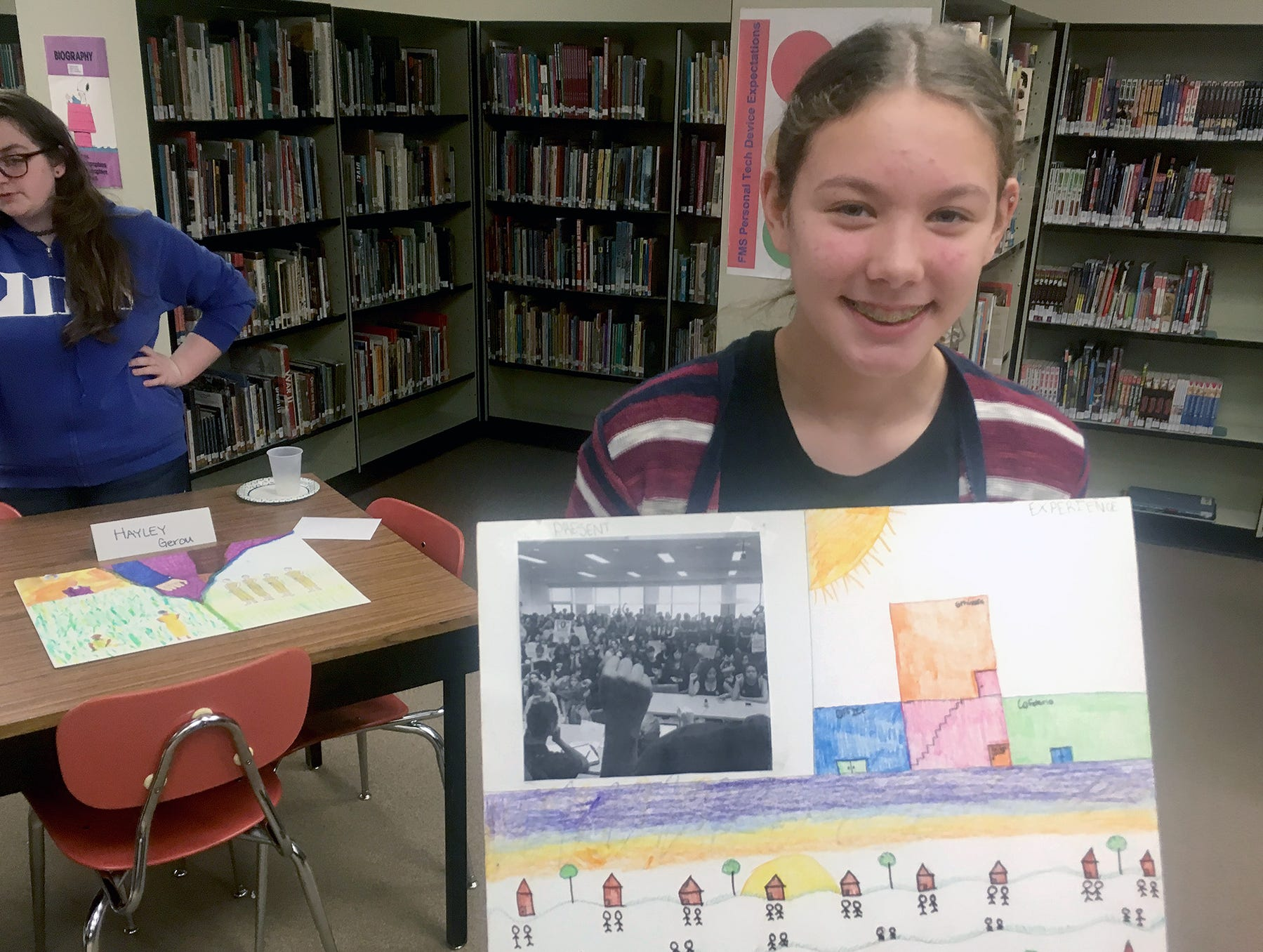 Fairview Middle School student Kamryn Merryman showed the Underground Railroad in her artwork for a project in Amy White's U.S. History class, focused on the history of racial discrimination. Merryman also depicted racism she observed in her elementary school.