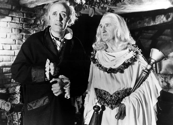 Alistair Sim (left) as Ebenezer Scrooge, with Michael Dolan as the Spirit of Christmas Past.
