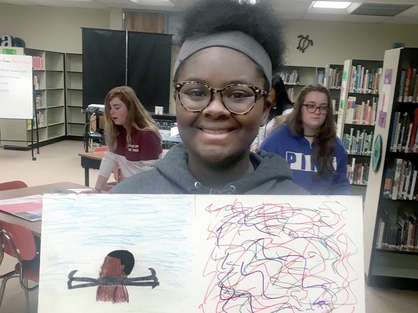 "Kaleah Riley, a student at Fairview Middle School, drew an ape as part of her artwork for a project in Amy White's U.S. History class focused on the history of racial discrimination. ""People have called me 'monkey' and 'gorilla' because of my skin tone,"" Riley said."