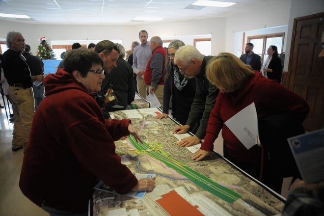 Area residents look over a potential design for an I-40 interchange at Blue Ridge Road on Dec. 13 in the Lakeview Center.