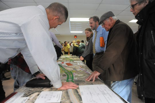During a public meeting in the Lakeview Center on Dec. 13, NCDOT officials unveiled potential designs for an I-40 interchange at Blue Ridge Road. Community members were given the opportunity to ask questions and provide feedback on the project.