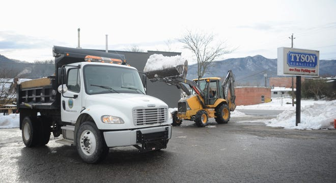 Four days after a winter storm descended on the Swannanoa Valley, Black Mountain Public Services crews work to remove snow downtown.