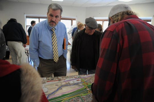 Steven Cannon, the project development engineer for NCDOT Division 13, listens to a question about a potential design for an I-40 interchange at Blue Ridge Road during a public meeting on Dec. 13.