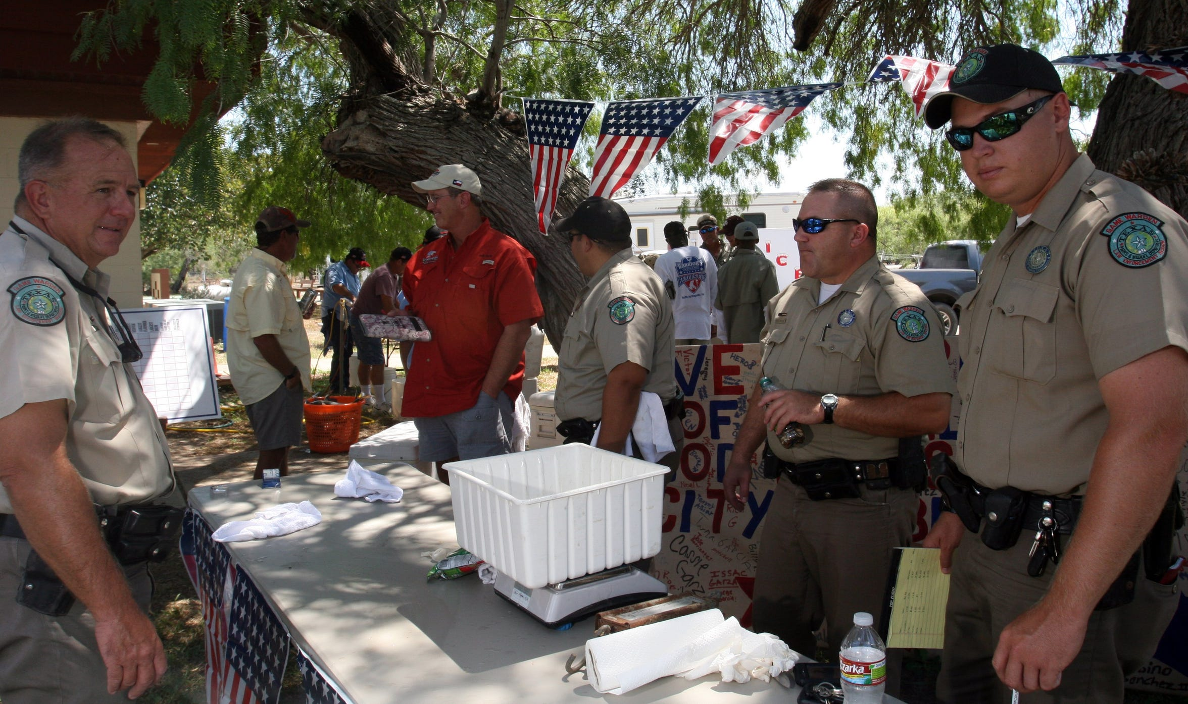 Texas Game Wardens act as weighmasters during a Warrior's Weekend Heroes Cup at Baffin Bay.