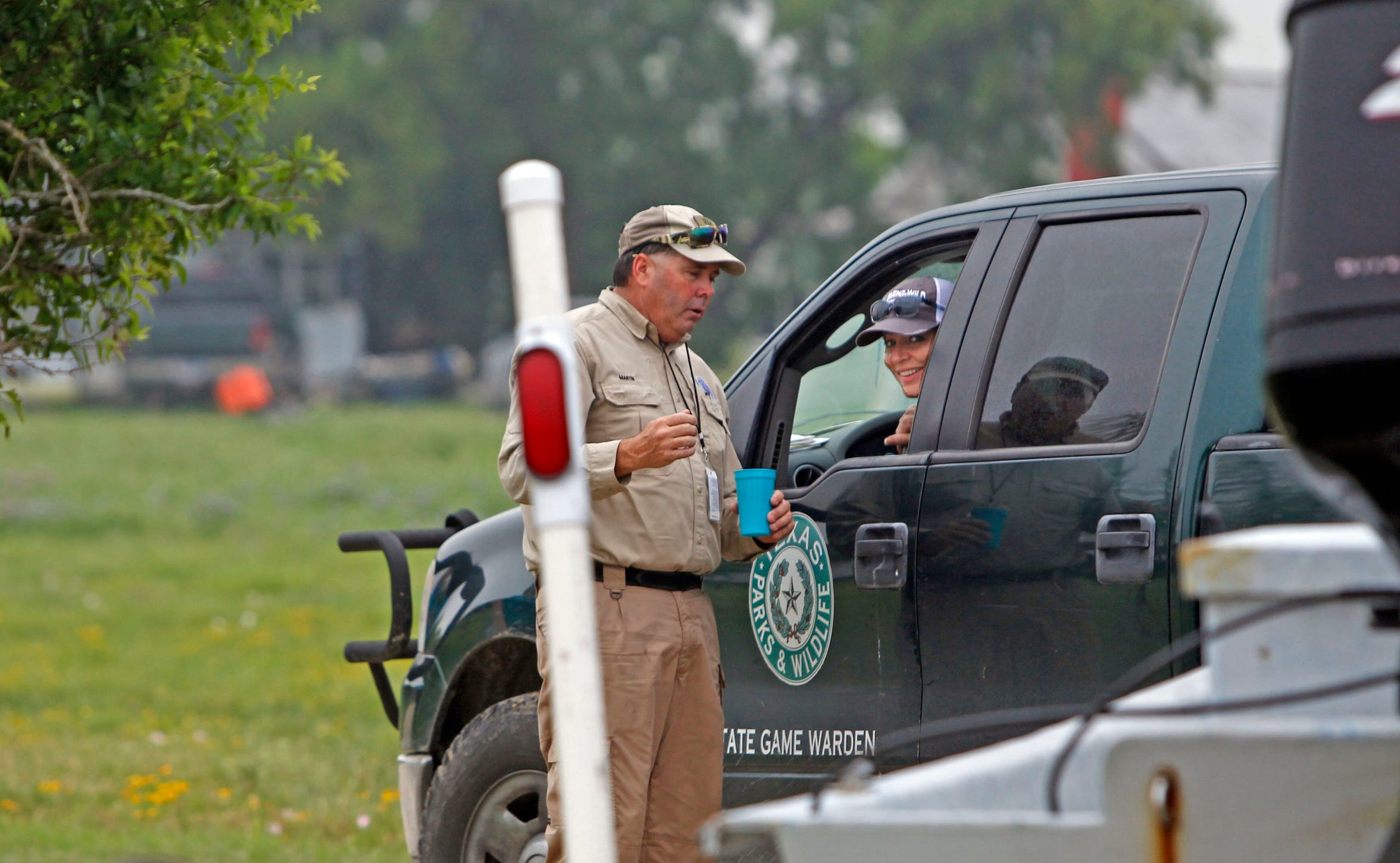 Texas game Warden Marty Martin calmly instructs Kari Kelley on how to back up a boat and trailer down a ramp during a Rockport Women in the Wild event.