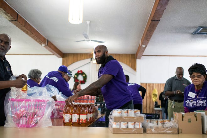Philadelphia Eagles safety Malcolm Jenkins puts together holiday dinner baskets with his foundation Monday, Dec. 17, 2018 in Camden, N.J.