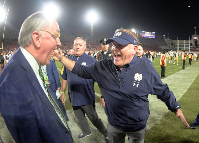 Nov 24, 2018; Los Angeles, CA, USA; Notre Dame Fighting Irish head coach Brian Kelly celebrates with athletic director Jack Swarbrick after the game against the Southern California Trojans at Los Angeles Memorial Coliseum. Notre Dame defeated USC 24-17.