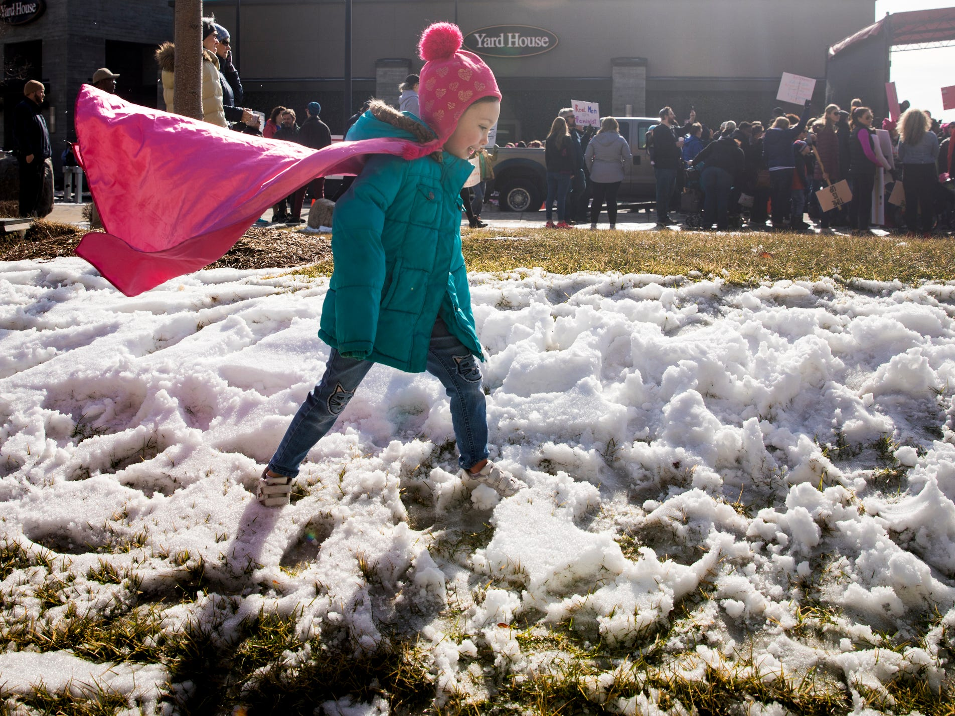 Thousands gathered for the second Cincinnati Women's March in January. The crowd was overwhelming and hard to move through. I stayed along the fringe looking for quieter moments and that's when I saw Dahlia. With a handmade pink cape, she trudged through the snow, chanting along with the marchers. Her mom watched her with pride. I loved seeing this moment in Cincinnati with people of all ages and backgrounds coming together.