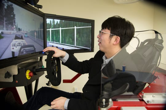 Jiaqi Ma, an assistant professor at the University of Cincinnati, demonstrates the simulator that's been developed in the mobility lab he runs in Rhodes Hall. Ma's main research area is cooperative automation and intelligent transportation systems. Specifically, he's looking at vehicles that will be equipped with special devices to talk to each other and the infrastructure.