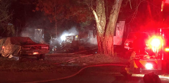 Fire and an explosion destroyed a mobile home in Northern Kentucky early Monday, fire officials said.