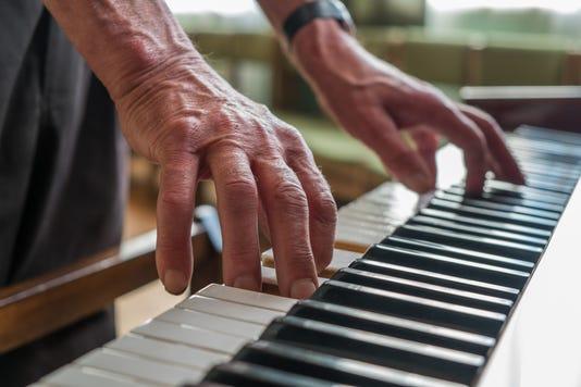 Senior Man Playing Piano