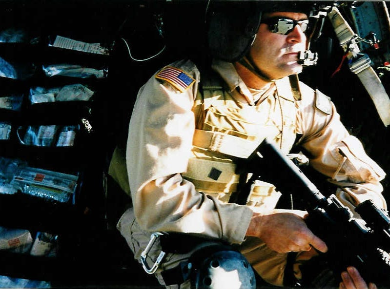 """Mark Green, the author of """"A Night with Saddam,"""" prepares to lift off on a mission while serving with the 160th Special Operations Aviation Regiment."""
