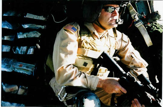 "Mark Green, the author of ""A Night with Saddam,"" prepares to lift off on a mission while serving with the 160th Special Operations Aviation Regiment."