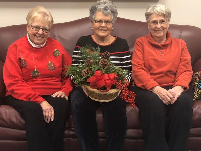 (Left to right)Bridgewater Garden Club member Sarah Schwarz, and Master Gardeners Carol Murphy, and Bonnie Johnson.