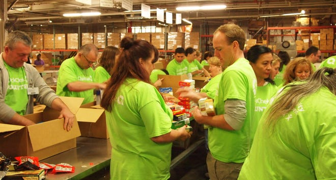 Thirty volunteers from the QuickChek's headquarters in the Whitehouse Station section of Readington and various stores sorted and packed donated food at the Community Food Bank of New Jersey in Hillside on Thursday, Dec. 13.