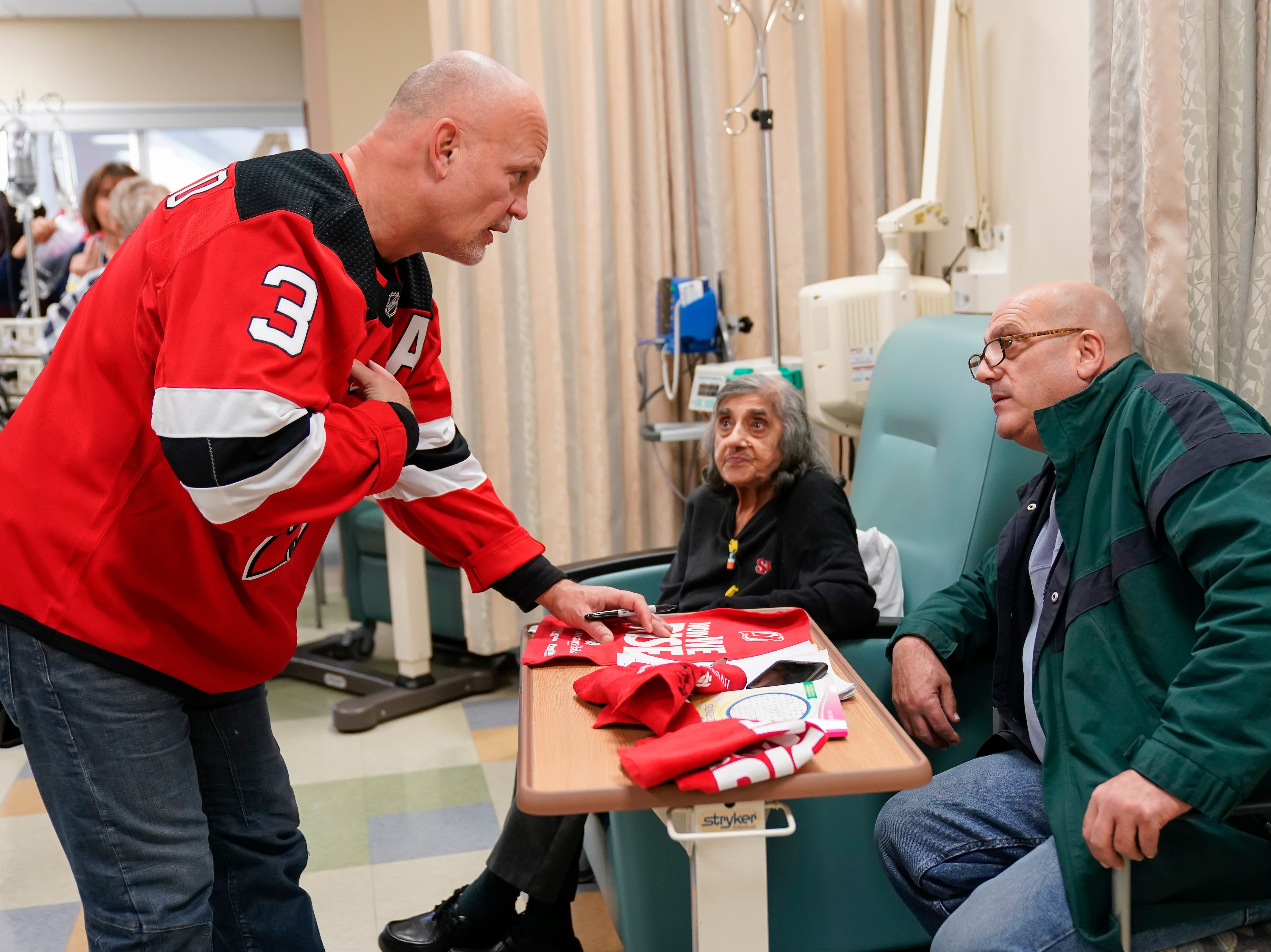 Three-time New Jersey Devils Stanley Cup winner Ken Danyeko was one of several Devils players, alumni and staff who visitedRWJ Barnabas Health sites Monday. At RWJUH Somerset, Daneyko charmed visitors, patients, such as Stella and Tony Gatti of North Plainfield,, and staff alike visiting several oncology units at both the Steeplechase Cancer Center and Paul R.NardoniOncology Pavilionof the main hospital.