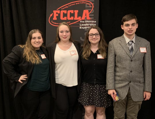 Left to right, Hunterdon County Polytech's FCCLA chapter officers Rosa Castaldo (Early Childhood Education), Casey Brady, Lynn Wyer and Justin Eanonne (Teacher Academy) participate in the Fall Leadership Connection for the New Jersey delegation of FCCLA at the Pines Manor in Edison.