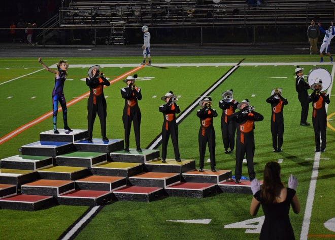 The Somerville High School marching band performs during the season.