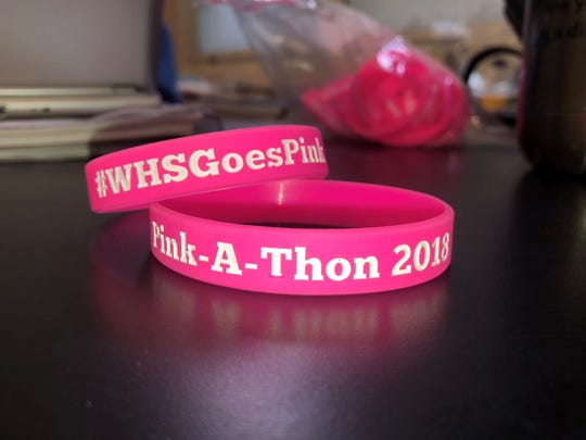 Silicone wristbands Preethy John sold as part of her fundraising efforts.