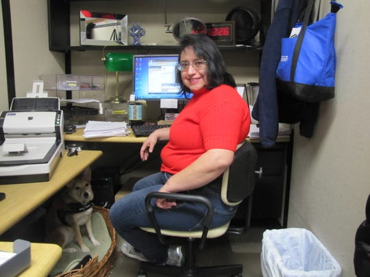 Diana, who received employment supports from Alternatives' Bridges to Employment Career Development Center, reports to her new job.