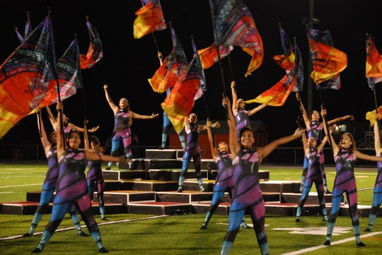 The Somerville High School color guard performs during the season.