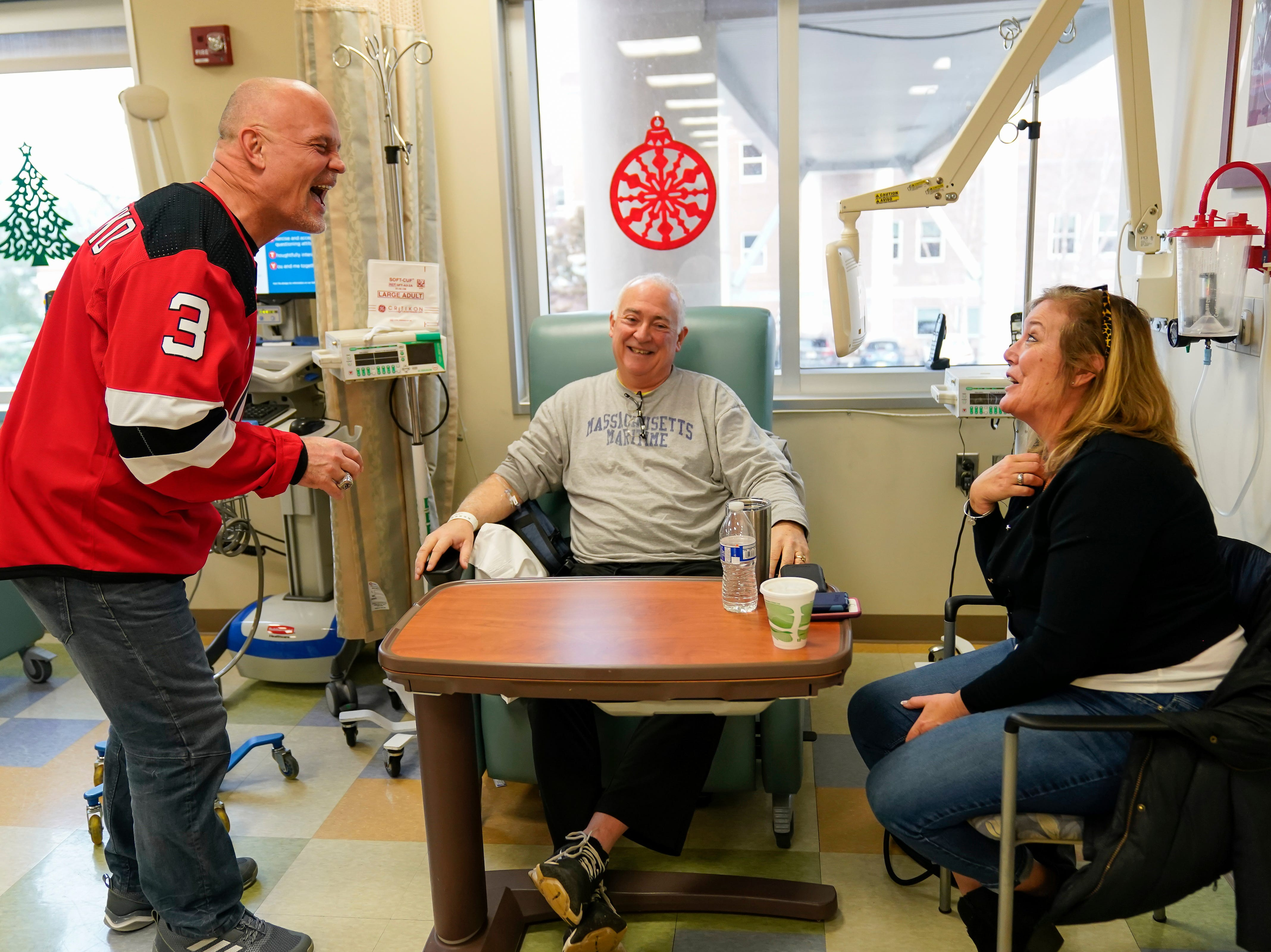 Three-time New Jersey Devils Stanley Cup winner Ken Danyeko was one of several Devils players, alumni and staff who visitedRWJ Barnabas Health sites Monday. At RWJUH Somerset, Daneyko charmed visitors, patients, such as Eddie and Maggie Smith of Bridgewater, and staff alike visiting several oncology units at both the Steeplechase Cancer Center and Paul R.NardoniOncology Pavilionof the main hospital.