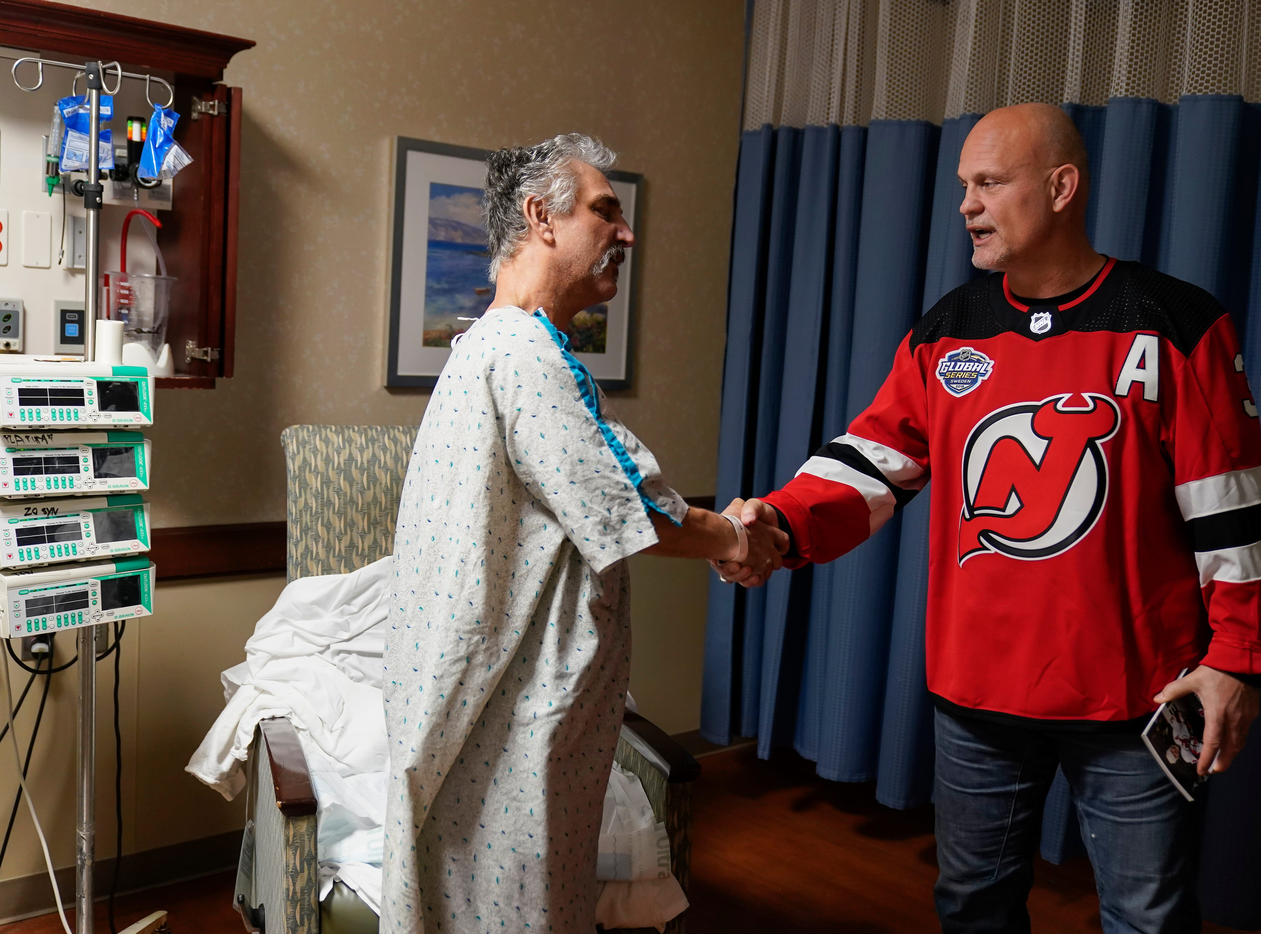 Three-time New Jersey Devils Stanley Cup winner Ken Danyeko was one of several Devils players, alumni and staff who visitedRWJ Barnabas Health sites Monday. At RWJUH Somerset, Daneyko charmed visitors, patients, such as chris Corra of Raritan, and staff alike visiting several oncology units at both the Steeplechase Cancer Center and Paul R.NardoniOncology Pavilionof the main hospital.