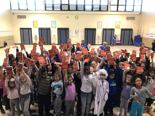 Dictionaries help Manville third-graders learn about charity