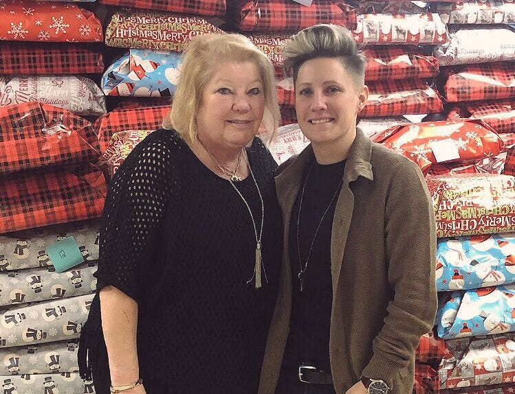 """A Santa Claus of sorts, New Brunswick teacher Jennifer Olawski is ensuring that every single of of her more than 450 students will receive a gift this holiday season. Continuing a program she began in her former school, Olawski, a physical education and health teacher at Livingston Elementary School, created a GoFundMe campaign to raise funds for gifts for the children. This year's effort saw more than $10,000 in donations and the help of many """"elves,"""" including her mother Frances Forjan."""
