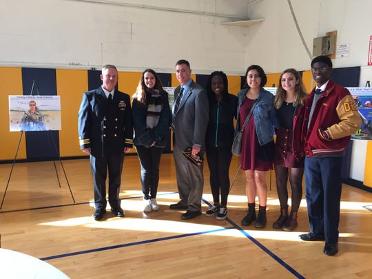 (Left to right) Executive Officer LCDR Eric P. Rion, Mackenzie Toth of Milford, Somerset County Vocational & Technical High School Social Studies Instructor Ed Graf, Eka Tawe of Hillsborough, Anna Ramos of Warren, Mae Kinst of Hillsborough and Jamie Moni of Hillsborough.